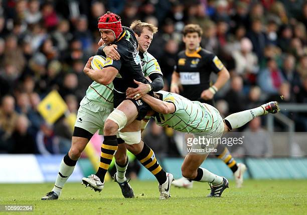 Dan WardSmith of London Wasps is tackled by Stephen Myler during the AVIVA Premiership match between London Wasps and Northampton Saints at Adams...