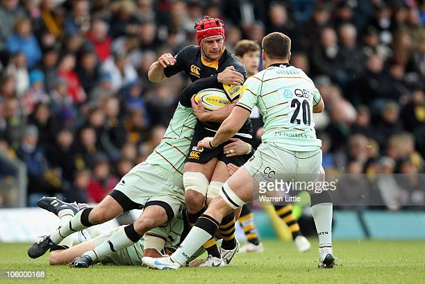 Dan WardSmith of London Wasps is tackled during the AVIVA Premiership match between London Wasps and Northampton Saints at Adams Park on October 24...