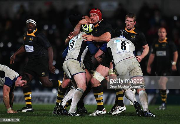 Dan WardSmith of Wasps is stopped by Sam Vesty and Ben Skirving of Bath during the London Wasps and Bath LV Anglo Welsh Cup match at Adams Park on...