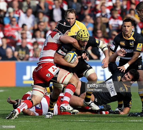 Dan WardSmith of Wasps is tackled by Alasdair Strokosch during the Aviva Premiership match between Gloucester and London Wasps at Kingsholm on...