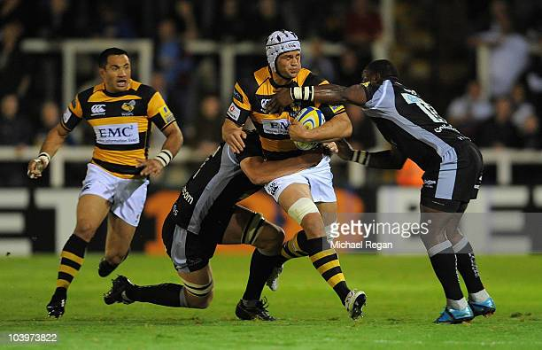 Dan WardSmith of Wasps is tackled by Ally Hogg and Gcobani Bobo of Newcastle during the AVIVA Premiership match between Newcastle Falcons and London...