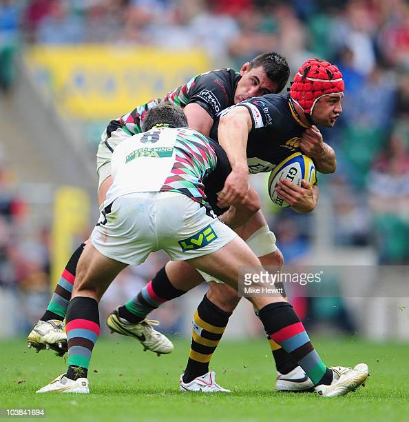 Dan WardSmith of Wasps is tackled by Nick Easter and Chris Robshaw of Harlequins during the AVIVA Premiership match between London Wasps and...