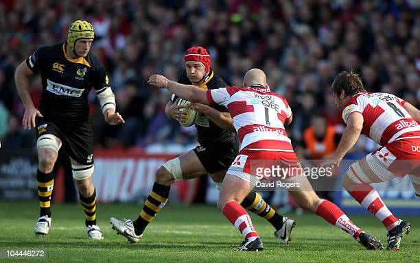 Dan WardSmith of Wasps is tackled by Nick Wood during the Aviva Premiership match between Gloucester and London Wasps at Kingsholm on September 25...