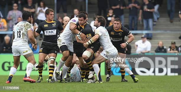 Dan WardSmith of Wasps is tackled during the Aviva Premiership match between London Wasps and Leeds Carngie at Adams Park on April 17 2011 in High...