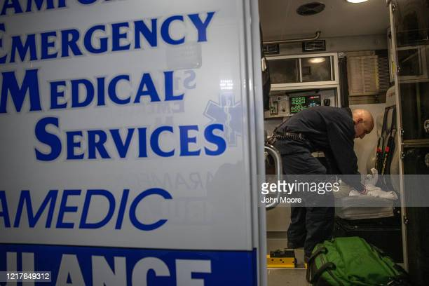 Dan Wellen cleans the ambulance after transporting a patient with COVID-19 symptoms to Stamford Hospital on April 03, 2020 in Stamford, Connecticut....