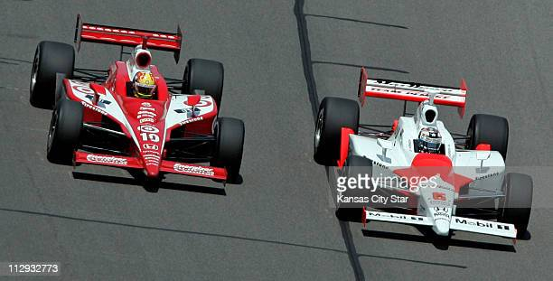 Dan Wheldon and Sam Hornish Jr race side by side during the final laps of the Kansas Lottery Indy 300 at the Kansas Speedway in Kansas City Missouri...
