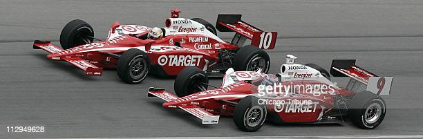 Dan Wheldon and teammate Scott Dixon are head to head coming out of turn three during the Peak Antifreeze Indy 300 at the Chicagoland Speedway in...