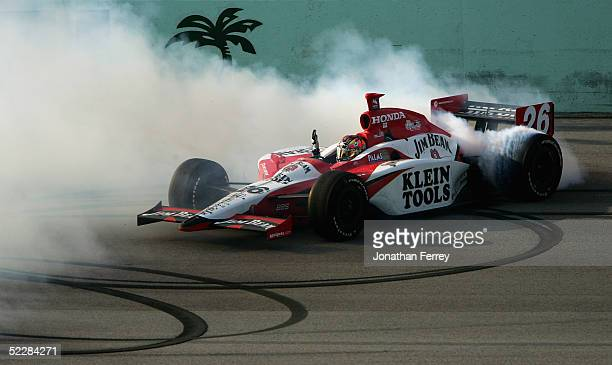 Dan Wheldon driver of the Andretti Green Racing Jim Beam Honda Dallara celebrates his win with victory doughnuts during the IRL IndyCar Series Toyota...