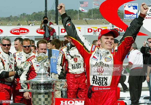 Dan Wheldon, driver of the Andretti Green Racing Jim Beam/Klein Tools Honda Dallara celebrates winning the Indy Racing League IndyCar Series...