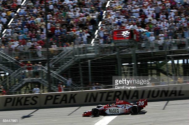 Dan Wheldon driver of the Andretti Green Racing Klein Tools/Jim Beam Dallara Honda wins the Indy Racing League IndyCar Series Honda Indy 225 on...