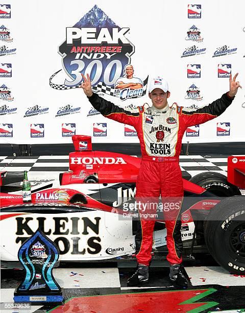 Dan Wheldon driver of the Andretti Green Racing Klein Tools/Jim Beam Dallara Honda celebrates winning the Indy Racing League IndyCar Series Peak...