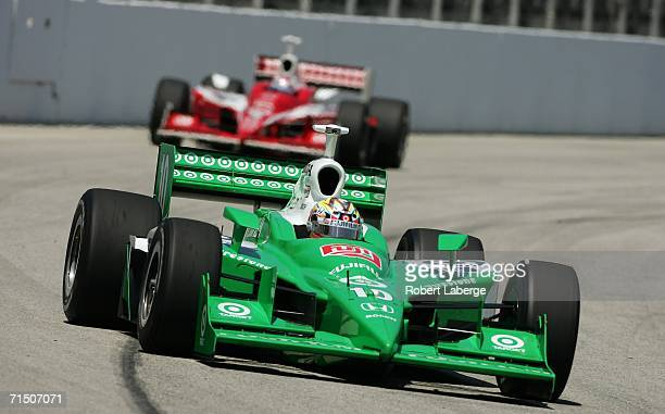 Dan Wheldon driver of the Chip Ganassi Racing Fujifilm Dallara Honda leads his teammate Scott Dixon in his Target Chip Ganassi Racing Dallara Honda...