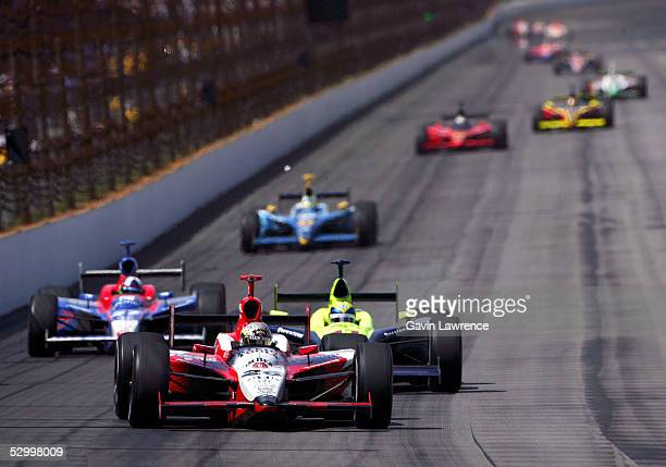 Dan Wheldon driver of the Klein Tools/Jim Beam Andretti Green Racing Jim Dallara Honda leads Vitor Meira driver of the Rahal Letterman Menards Johns...