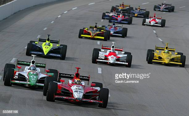 Dan Wheldon driver of the Klein Tools/Jim Beam Andretti Green Racing Jim Dallara Honda leads Tony Kanaan driver of the Team 7Eleven Andretti Green...