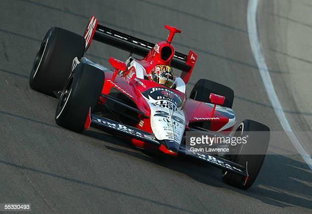 Dan Wheldon driver of the Klein Tools/Jim Beam Andretti Green Racing Jim Dallara Honda drives during practice for the Indy Racing League IndyCar...