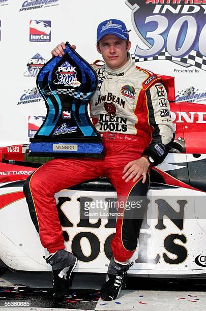 Dan Wheldon driver of the Klein Tools/Jim Beam Andretti Green Racing Jim Dallara Honda poses in victory lane after winning the Indy Racing League...