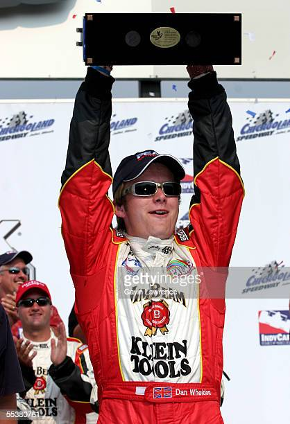 Dan Wheldon driver of the Klein Tools/Jim Beam Andretti Green Racing Jim Dallara Honda holds the trophy after winning the Indy Racing League IndyCar...