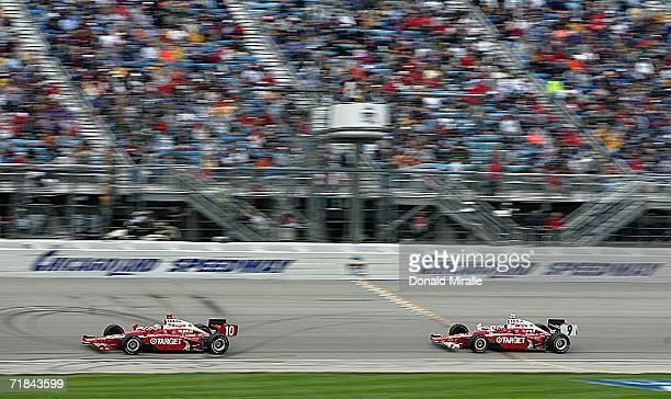Dan Wheldon driver of the Target Chip Ganassi Dallara Honda leads his teammate Scott Dixon #9 Target Chip Ganassi in the final laps during the IRL...
