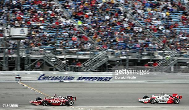 Dan Wheldon driver of the Target Chip Ganassi Dallara Honda leads Sam Hornish Jr driver of the Marlboro Team Penske Honda Dallara intop the final lap...
