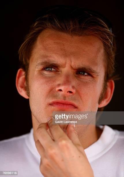 Dan Wheldon driver of the Target Chip Ganassi Racing Dallara Honda looks up during qualifying for the Indy Racing League IndyCar Series Peak...