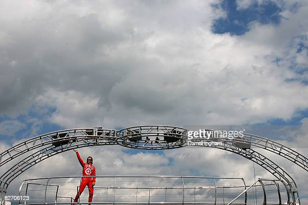 Dan Wheldon driver of the Target Chip Ganassi Racing Dallara Honda waves to the crowd before the start of the IRL IndyCar Series PEAK Antifreeze...