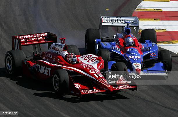 Dan Wheldon driver of the Target Ganassi Racing Dallara Honda and Marco Andretti driver of the ArcaEx Andretti Green Racing Dallara Honda collide...