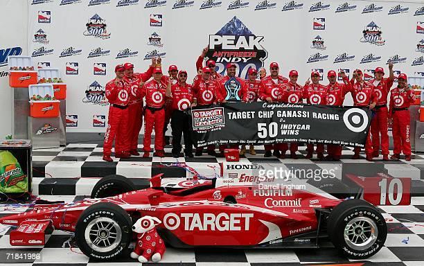 Dan Wheldon driver of the Target Ganassi Racing Dallara Honda celebrates with his crew after winning the teams 50th race at the IRL IndyCar Series...