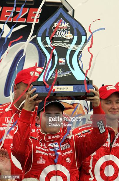 Dan Wheldon hoists the trophy after winning the Peak Antifreeze Indy 300 at the Chicagoland Speedway in Joliet Illinois Sunday September 10 2006