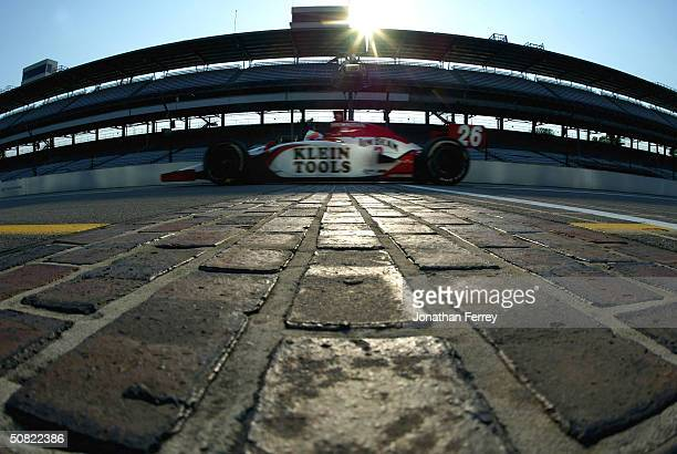 Dan Wheldon in his Andretti Green Racing Jim Beam Honda Dallara aims to cross the bricks first during the IRL IndyCar Series Indianapolis 500 testing...