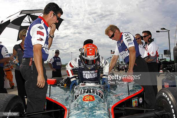 Dan Wheldon of England driver of the National Guard Panther Racing Dallara Honda gets into his car during qualifying for the IRL Indycar Series Iowa...