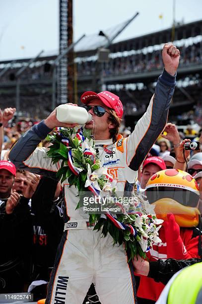 Dan Wheldon of England driver of the William RastCurb/Big Machine Dallara Honda drinks milk as he celebrates in victory lane after winning the IZOD...