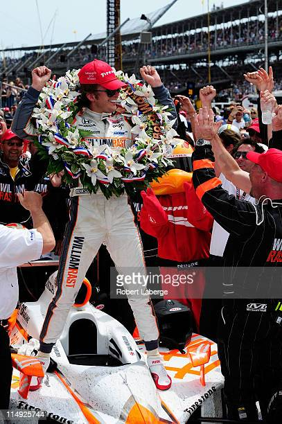 Dan Wheldon of England driver of the William RastCurb/Big Machine Dallara Honda celebrates in victory lane after winning the IZOD IndyCar Series...