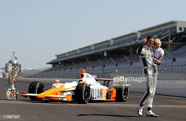 Dan Wheldon of England driver of the William RastCurb/Big Machine Dallara Honda walks with son Sebastian Wheldon during the 95th Indianapolis 500...
