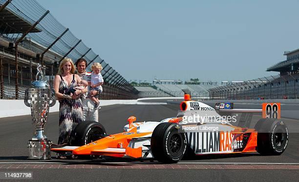Dan Wheldon of England driver of the William RastCurb/Big Machine Dallara Honda poses with his wife Susie and his new born Oliver and son Sebastian...