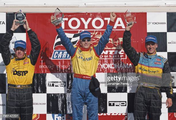 Dan Wheldon of Great Britain driver of the PPI Motorsports Swift 011c Toyota celebrates with second placed David Rutledge and third placed Buddy Rice...