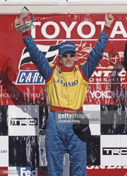 Dan Wheldon of Great Britain driver of the PPI Motorsports Swift 011c Toyota celebrates winning the Championship Auto Racing Teams Toyota Formula...
