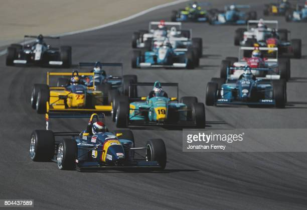 Dan Wheldon of Great Britain driver of the PPI Motorsports Swift 011c Toyota leads the field during the Championship Auto Racing Teams Toyota Formula...