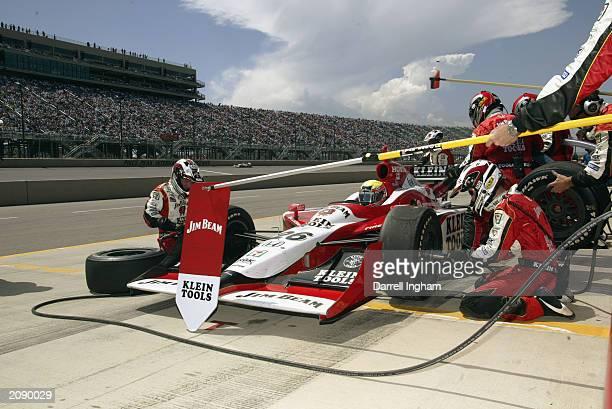 Dan Wheldon pits his Andretti Green Racing Jim Beam/Klein Tools Honda Dallara during the IRL Honda Indy 225 IndyCar Series at the Pikes Peak...