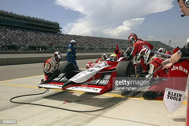 Dan Wheldon pits his Andretti Green Racing Jim Beam/Klein Tools Honda Dallara during the IRL IndyCar Series Honda Indy 225 at the Pikes Peak...