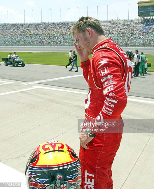 Dan Wheldon put his hand on his head minutes after finishing a close second to Sam Hornish Jr in the Kansas Lottery Indy 300 at Kansas Speedway in...
