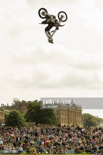 Dan Whitby of the Bolddog Lings FMX Display Team performs in the Grand Ring on the first day of the Chatsworth Country Fair in the grounds of...