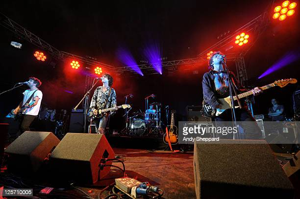 Dan White, Johnny Lloyd, Miguel Demelo and Jim Cratchley of British band Tribes perform on stage during day two of Reading Festival 2011 at Richfield...