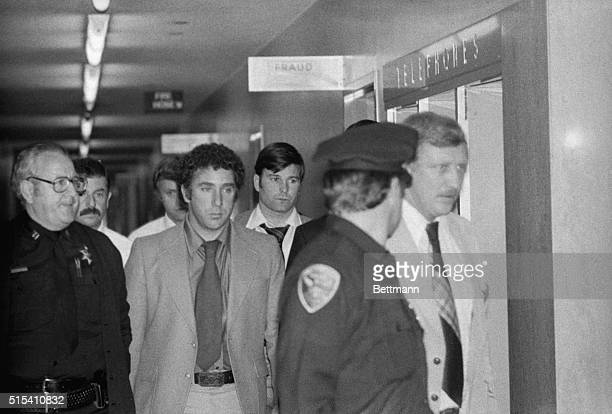Dan White suspect in the killing of San Francisco Mayor George Moscone Supervisor Harvey Milk is led by police officers towards jail elevator at Hall...