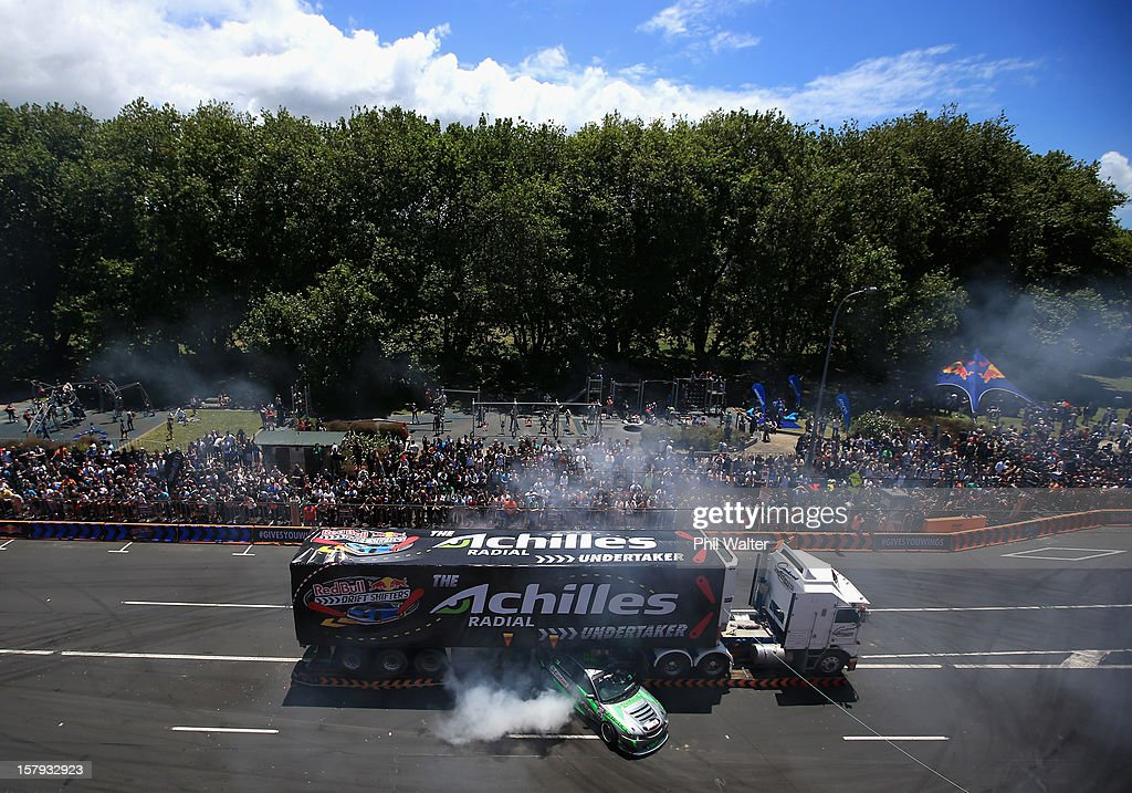 Dan Woolhouse of New Zealand competes in the Red Bull Drift Shifters along Victoria Street on December 8, 2012 in Auckland, New Zealand.