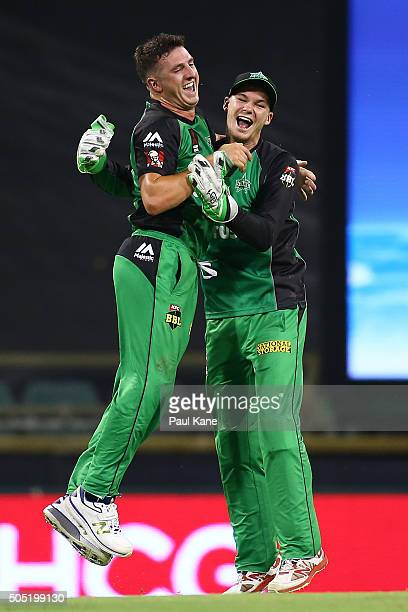 Dan Worrall and Peter Handscomb of the Stars celebrate the wicket of Ashton Agar of the Scorchers during the Big Bash League match between the Perth...