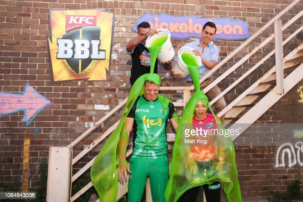 Dan Worrall of the Melbourne Stars and Lauren Smith of the Sydney Sixers are slimed during the BBL Nickelodeon Partnership Media Opportunity at The...