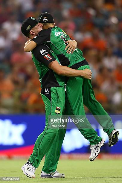 Dan Worrall of the Stars lifts Seb Gotch after taking a catch to dismiss Andrew Tye of the Scorchers during the Big Bash League match between the...