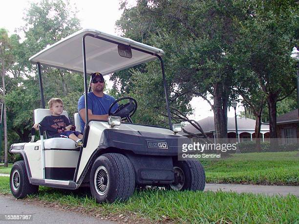 Dan Yates, right, of Windermere, picks up his son Finnigann from school at First Baptist Church Windermere, Florida, October 2, 2012. Last month, the...