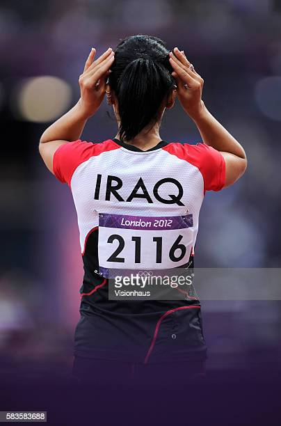 Dana Abdul Razak of Iraq prepares to run in the Womens 100m as part of the 2012 London Olympic Summer Games at the Olympic Stadium Olympic Park...