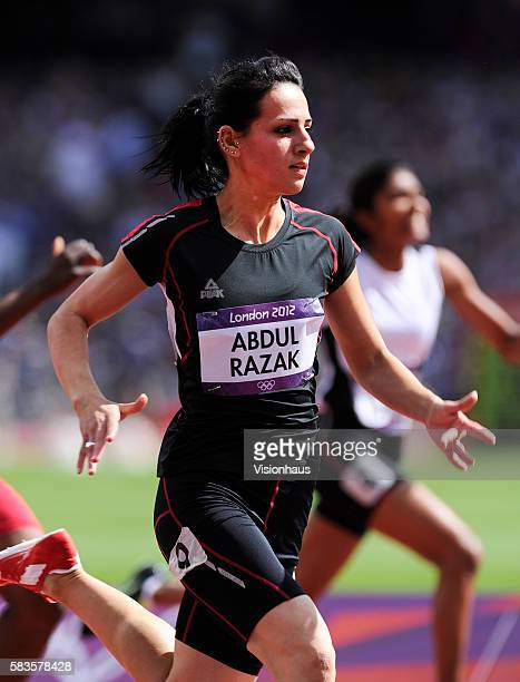 Dana Abdul Razak of Iraq takes part in the Womens 100m Preliminary Round as part of the 2012 London Olympic Summer Games at the Olympic Stadium...